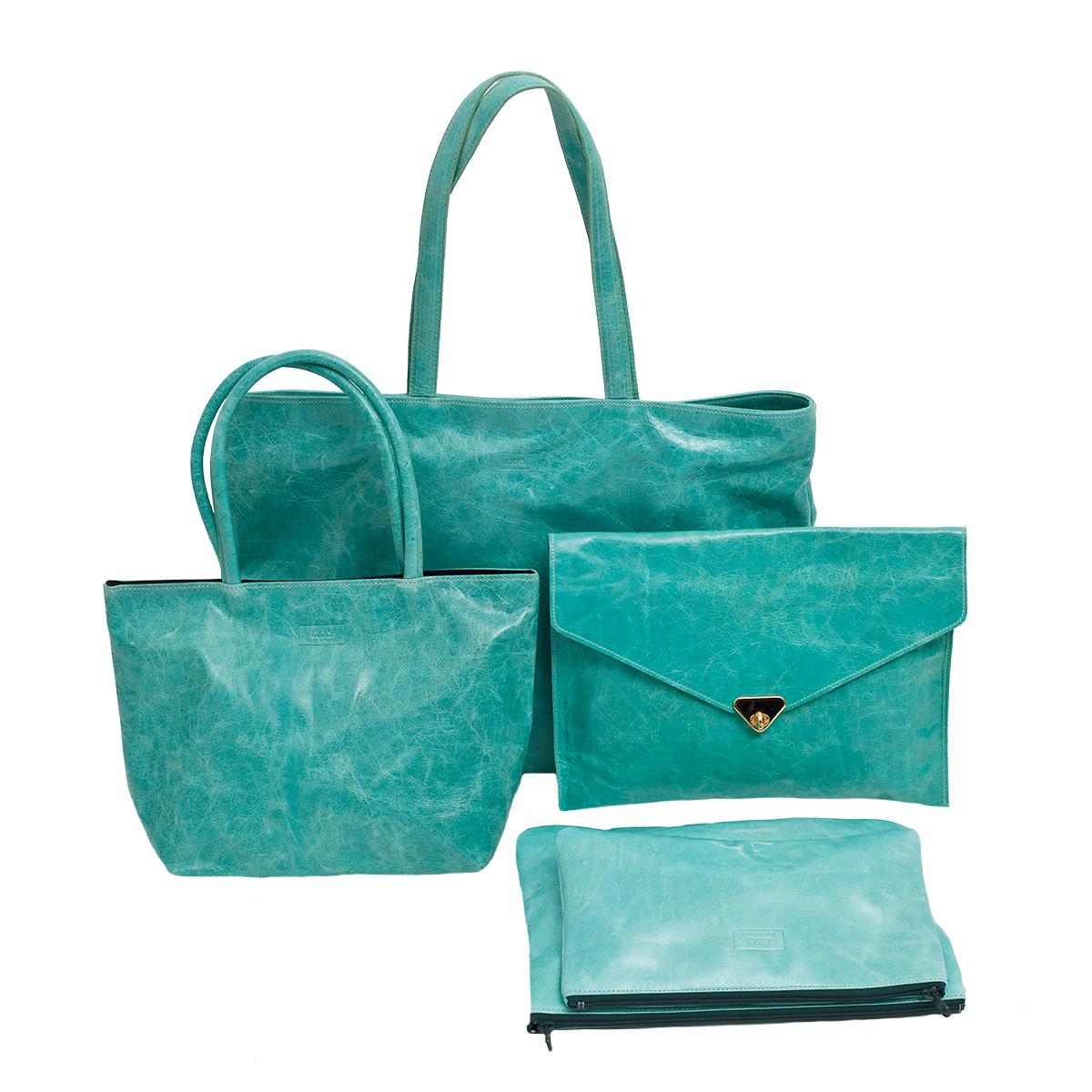 KIKA'S grand sac 1290€, petit sac 99€, pochette habillée 99€ et pochettes zippée 35/39€, le tout en cuir souple