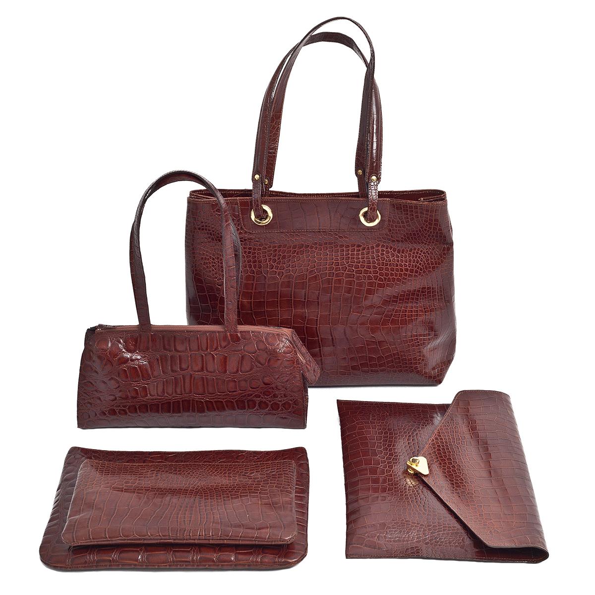 KIKA'S grand sac 199€, petit sac 120€, pochette habillée 99€ et pochettes zippée 35/39€, le tout en cuir façon croco.